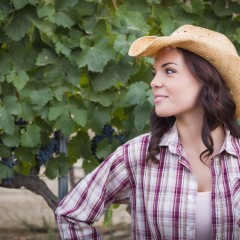 Young Mixed Race Adult Female Portrait Outside Wearing Cowboy Hat in Vineyard.